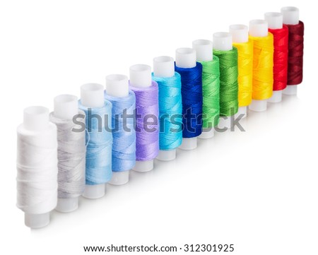 multicolored threads isolated on a white background. shallow depth of field Focus in the middle of the frame - stock photo