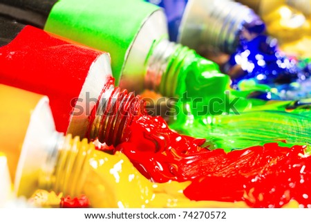 Multicolored tubes of paint. Several colors. shallow depth-of-field. - stock photo