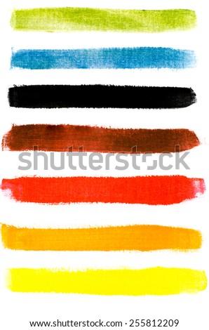 multicolored watercolor strokes on white paper background - stock photo