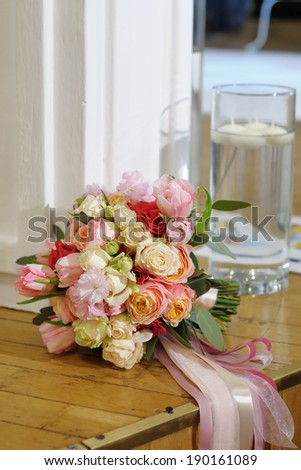 Multicolored wedding roses and tulips bouquet with silken ribbons - stock photo
