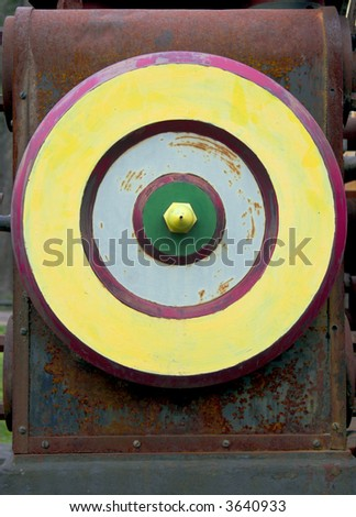Multicolored wheel of the vintage rusty steam engine. - stock photo
