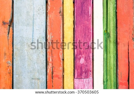 Multicolored wood background and alternative construction material - Texture on wooden panel in modern fashion structure - Retro seamless backdrop pattern - Soft vintage saturated filtered look - stock photo