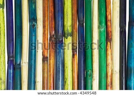 Multicolored Wooden pole fence background