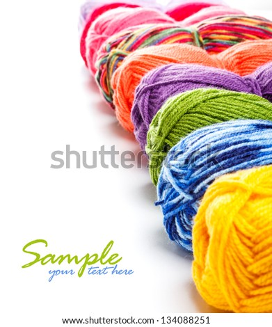Multicolored yarns in a row with space for your text - stock photo