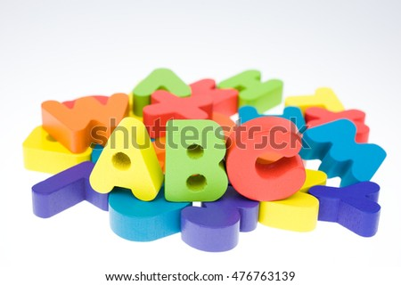 multicoloured bright wooden letters isolated on white background