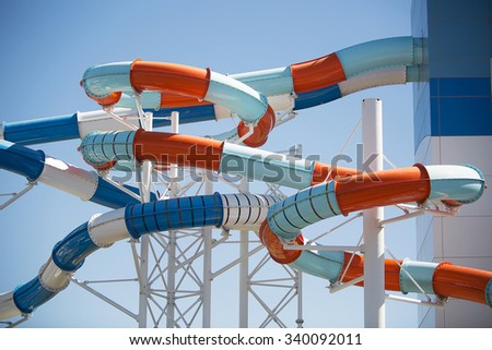 Multicoloured giant water slide at a public swimming pool