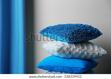 Multicoloured pillows in a room - stock photo