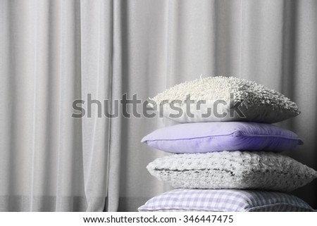 Multicoloured pillows on a curtain background - stock photo