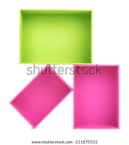 Multicoloured wooden boxes on white background isolated