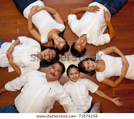 multicultural American family photographed from above laying in a ring. - stock photo