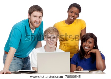 Multicultural College students/friends male and female, gathered around a computer - stock photo