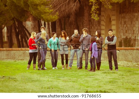 Multicultural group of young adult friends talking to each ...  Multicultural People Talking Together