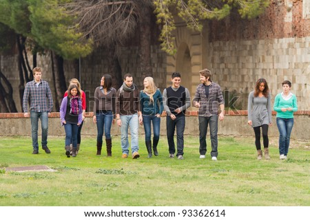 Multicultural Group of People Walking Together - stock photo