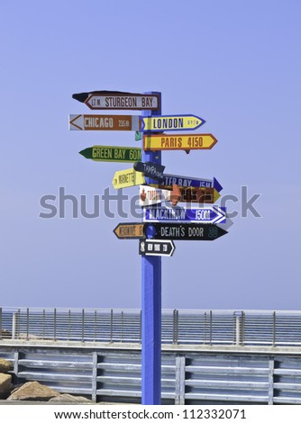 Multidirectional sign for tourists in Egg Harbor, Wisconsin - stock photo