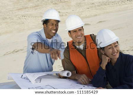 Multiethnic architects at construction site - stock photo