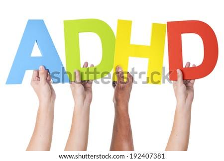 Multiethnic Arms Raised Holding ADHD - stock photo