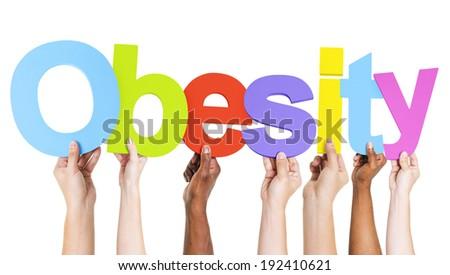 Multiethnic Arms Raised Holding Text Obesity - stock photo