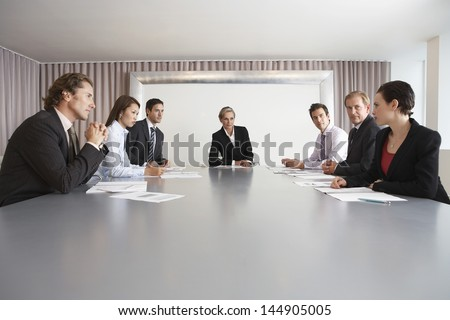 Multiethnic business people having discussion in meeting room - stock photo