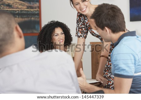 Multiethnic Businesspeople in meeting at conference table - stock photo