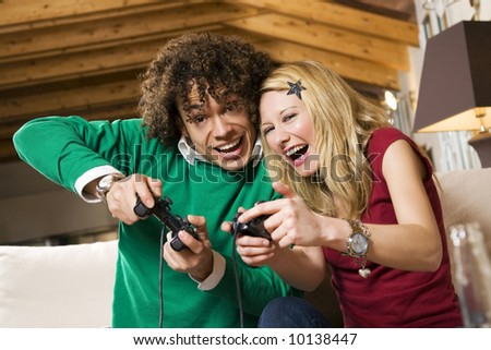 multiethnic couple having fun with a new videogame