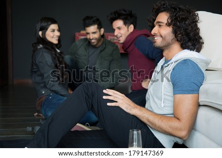 multiethnic group of friends hanging out on saturday night. Partying on saturday night