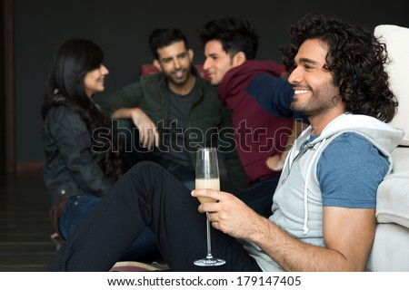 multiethnic group of friends hanging out on saturday night. Partying on saturday night - stock photo