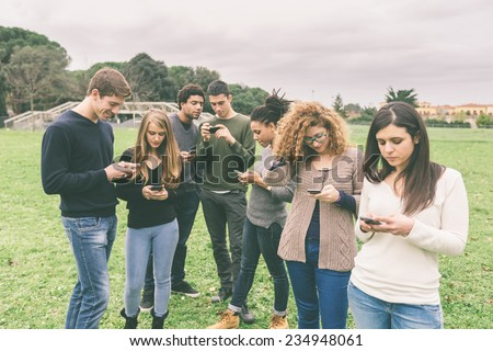 Multiethnic Group of Friends, Smart Phone Addicted - stock photo