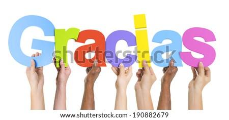 Multiethnic Group of Hands Holding Gracias - stock photo