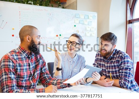 Multiethnic group of happy business people working together in office - stock photo