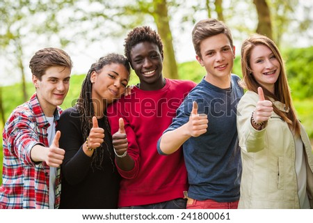 Multiethnic Group of Teenagers with Thumbs Up - stock photo