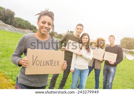 Multiethnic Group of Young Volunteers - stock photo