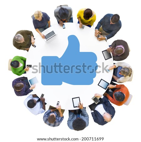 Multiethnic People Using Digital Devices with Thumbs Up Symbol - stock photo