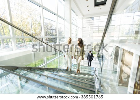 Multiethnic people walking in the office - stock photo
