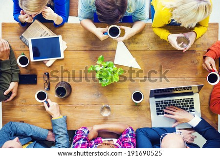 Multiethnic People with Startup Business Talking in a Cafe - stock photo
