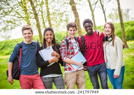 Multiethnic Teenage Students at Park - stock photo