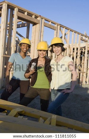 Multiethnic women  at construction site - stock photo