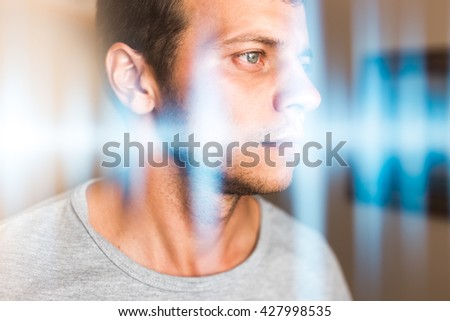 Multiexposure photo of a man and music waves. Hearing, perception of sounds and music - stock photo