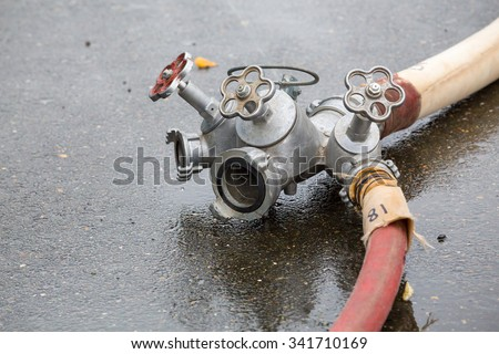 multifunctional iron faucet valves connected to the fire hose - stock photo