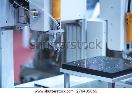 Multifunctional metal working with robot - stock photo