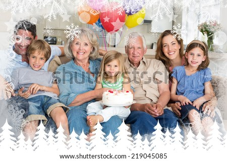 Multigeneration family celebrating girls birthday against fir tree forest and snowflakes