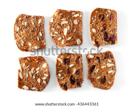 multigrain bread slices with fruits and nuts close-up on white background  - stock photo
