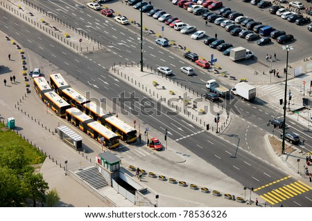 Multilane street, bus depot and parking lot in Warsaw, Poland, view from above - stock photo