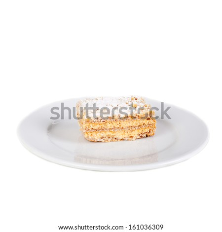 multilayer biscuit cake on the plate - stock photo
