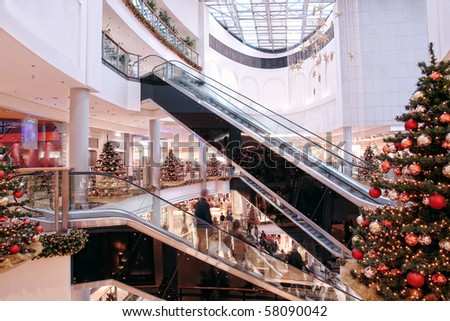 Multilevel shopping mall interior decorated with christmas trees - stock photo