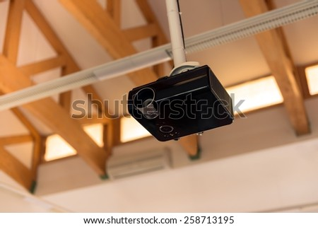 multimedia projector inside lecture hall closeup photo - stock photo