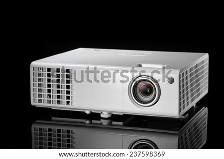 multimedia projector isolated on black background - stock photo