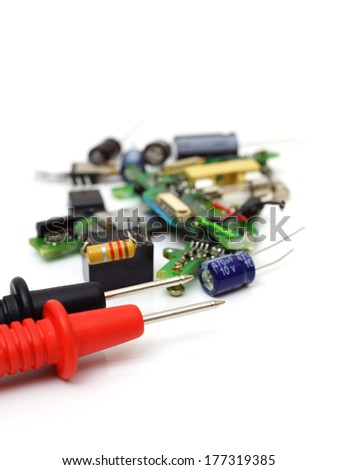 multimeter and electronic spare components isolated on white background - stock photo