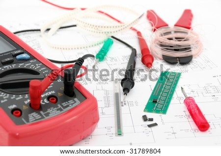 multimeter, electronic card, micro-schemes and instruments - stock photo