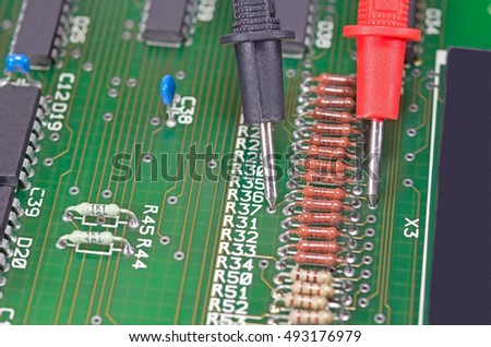 Multimeter,Resistors, electronic,Multimeter probes examining a resistors on electronic circuit board