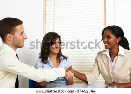 Multinational group of young business people greetings and introductions. - stock photo